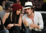 Canadian actress Nina Dobrev sits court side with an unidentified friend during Game 5 of the NBA Western Conference final playoff series between the Los Angeles Lakers and the Phoenix Suns in Los Angeles